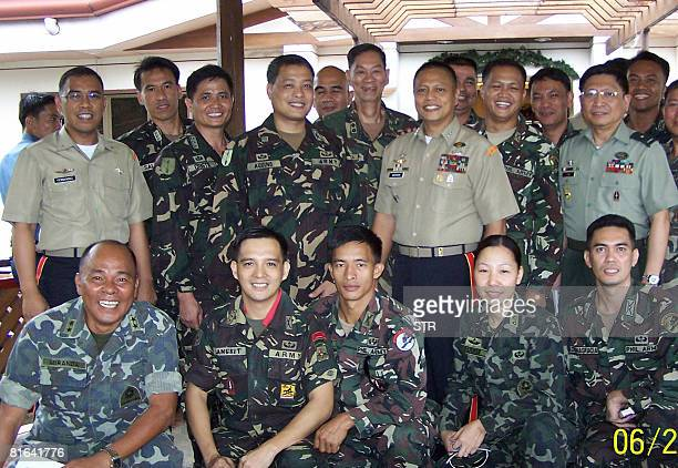 The group of 28 jailed officers charged with mutiny led by Major General Renato Miranda Brigadier General Danilo Lim and Colonel Ariel Querubin pose...