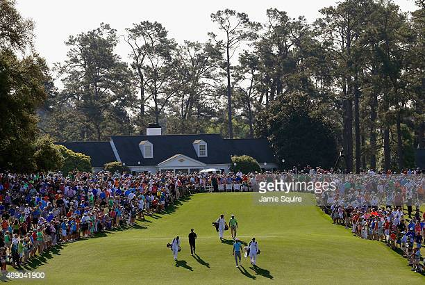 The group of Adam Scott of Australia Dustin Johnson of the United States and Amateur Antonio Murdaca of Australia walk off the first tee during the...