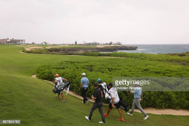 The group of Brice Garnett Corey Conners of Canada and Tyler McCumber walk from the 18th tee during the final round of the Corales Puntacana Resort...