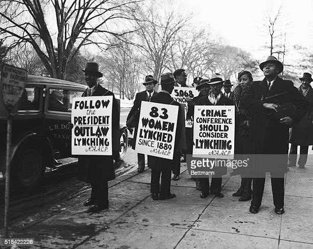 The group of colored pickets paraded before Constitution Hall as the National Crime Conference gathered for today's session. Their banners carried a...