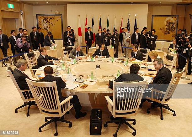 The Group of Eight leaders talk prior to the start of a meeting at the Windsor Hotel Toya July 8 2008 in Toyako Town Hokkaido Japan Climate change...