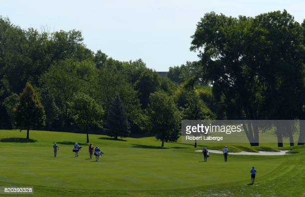 The group of Jeff Gove Anders Albertson and Dan McCarthy walks on the 14th fairway during round two of the Webcom Tour Pinnacle Bank Championship on...