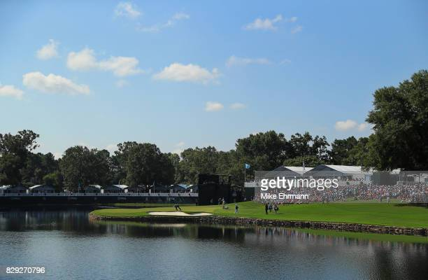 The group of Jordan Spieth of the United States, Brooks Koepka of the United States and Sergio Garcia of Spain walk up the 17th hole during the first...