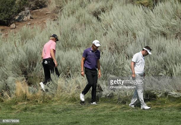 The group of Richy Werenski of the United States, Brett Drewitt of Australia and Charlie Danielson of the United States search for the ball of Richy...