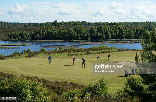 The Group of Robert Coles of England Garrick Porteous of England and Estanisao Goya of Argentina at the picturesque 6th green during the first day of...