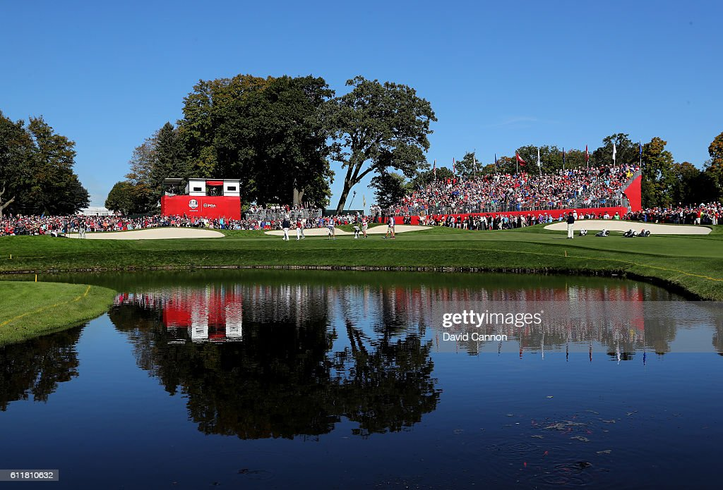 The group of Rory McIlroy and Thomas Pieters of Europe and Rickie Fowler and Phil Mickelson of the United States is seen on the 16th green during morning foursome matches of the 2016 Ryder Cup at Hazeltine National Golf Club on October 1, 2016 in Chaska, Minnesota.