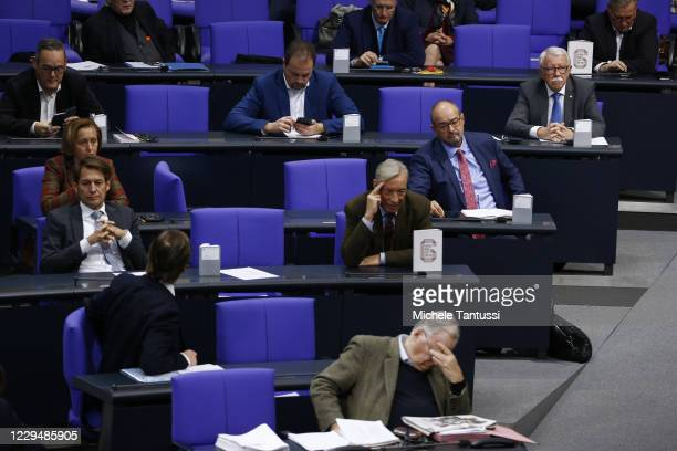 The group of the far right party AfD shows copies of the German constitution on their desks during a debate on the actual situation of the Covid-19...