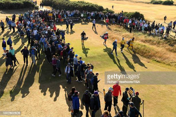 The grouping of Justin Rose of England Kiradech Aphibarnrat of Thailand and Jordan Spieth of the United States tees off at the 15th hole during round...