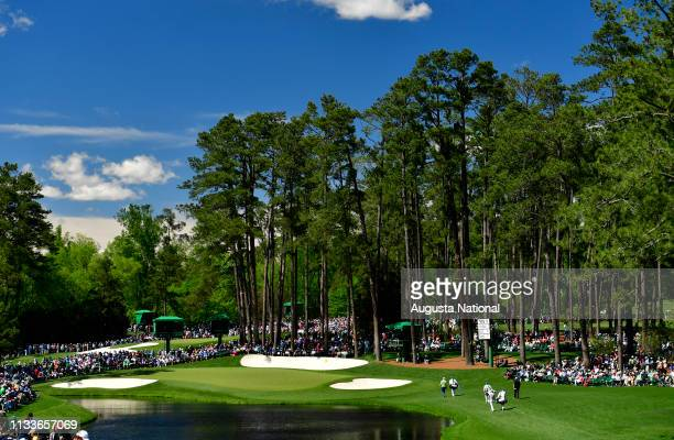 The grouping of Marc Leishman of Australia, Bill Haas and Justin Thomas walk to the No. 16 green during the second round of the Masters at Augusta...