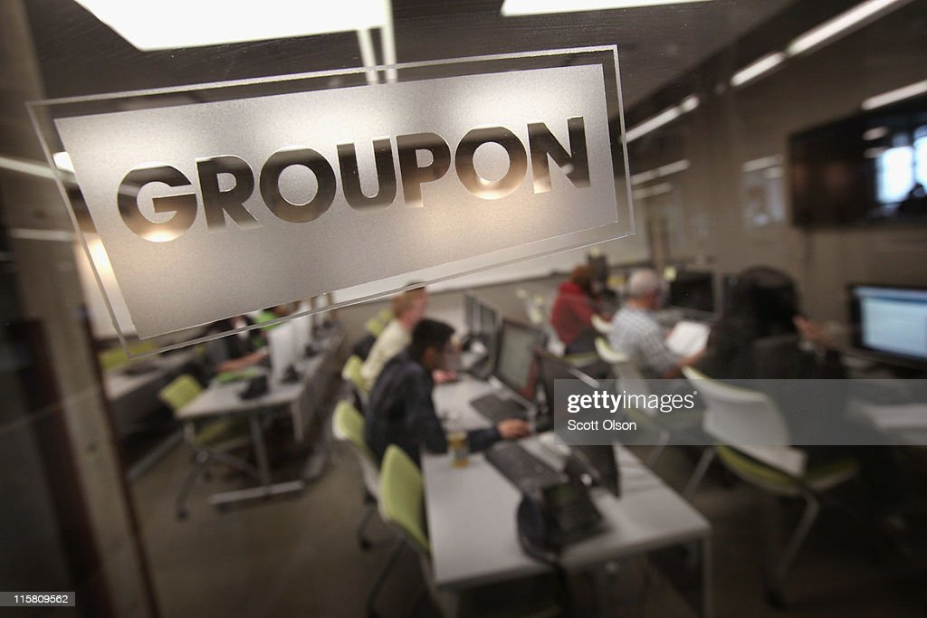 The Groupon logo is engraved in a glass office partition in the company's international headquarters on June 10, 2011 in Chicago, Illinois. Groupon, a local e-commerce marketplace that connects merchants and consumers by offering goods and services at a discount, announced June 2 that it had filed with the Securities and Exchange Commission for a proposed initial public offering of its Class A common stock. The company, launched in Chicago in November 2008 now markets products and services in 43 countries around the world.