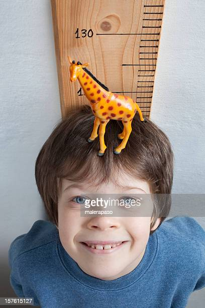 the growing child - white giraffe stockfoto's en -beelden