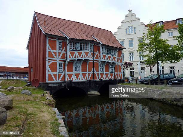 The Grube is a narrow river, one of Germany's oldest manmade urban waterways, connecting the Schweriner See with the Baltic Sea. Here,a half-timbered...