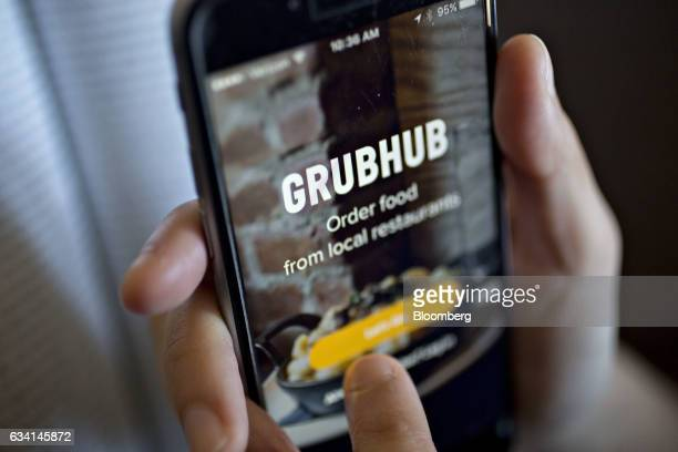 The GrubHub Inc application is demonstrated for a photograph on an Apple Inc iPhone in Washington DC US on Saturday Feb 4 2017 GrubHub is scheduled...