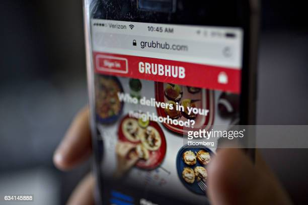 The GrubHub Inc website is demonstrated for a photograph on an Apple Inc iPhone in Washington DC US on Saturday Feb 4 2017 GrubHub is scheduled to...