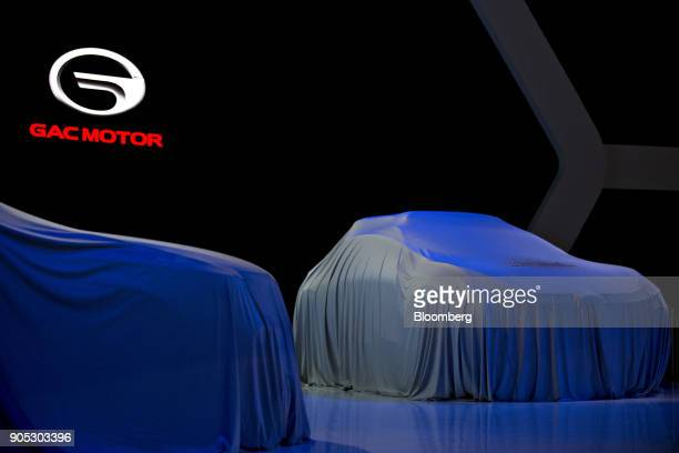 The Guangzhou Automobile Group Co Enverge electric concept vehicle right sits covered before being unveiled during the 2018 North American...