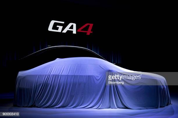 The Guangzhou Automobile Group Co GA4 sedan vehicle sits covered before being unveiled during the 2018 North American International Auto Show in...