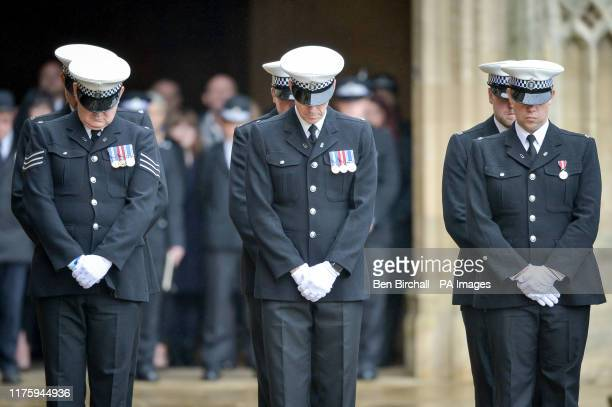 The guard of honour bow at the funeral of PC Andrew Harper, the Thames Valley Police officer who died from multiple injuries after being dragged...