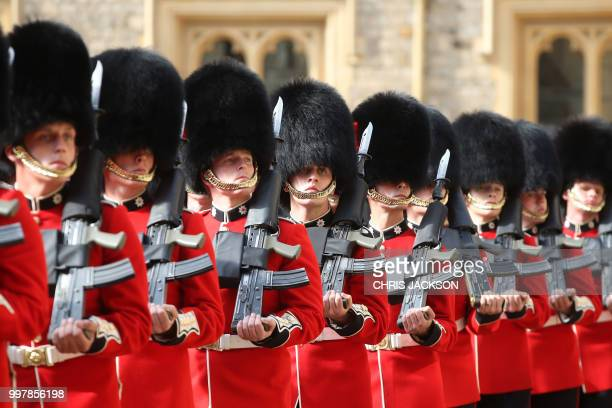 The guard of honour formed of the Coldstream Guards waits to perform a welcome ceremony at Windsor Castle in Windsor west of London on July 13 2018...
