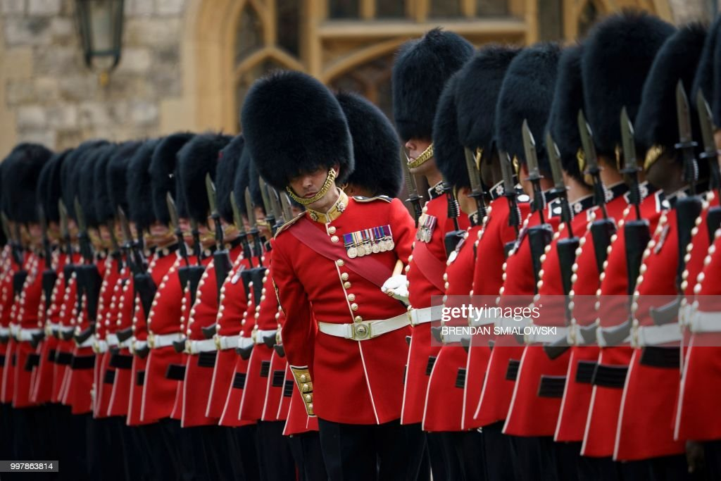 TOPSHOT - The Guard of Honour waits prior to inspection by Britain's Queen Elizabeth II and US President Donald Trump at Windsor Castle in Windsor, west of London, on July 13, 2018 on the second day of Trump's UK visit. - Queen Elizabeth II welcomed US President Donald Trump for tea at Windsor Castle on Friday -- a meeting which many Britons find the toughest part of his already contentious trip to swallow.