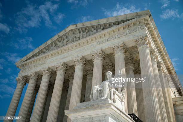 The Guardian or Authority of Law, created by sculptor James Earle Fraser, rests on the side of the U.S. Supreme Court on September 28, 2020 in...