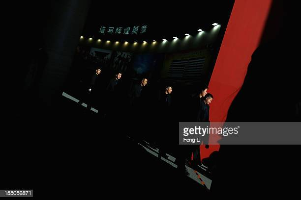 """The guards patrol as Chinese people visiting an exhibition entitled """"Scientific Development and Splendid Achievements"""" before the18th National..."""
