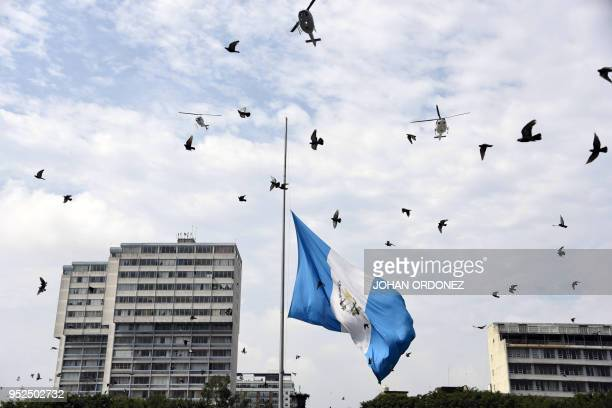The Guatemalan flag waves at half-mast during a ceremony to honour late Guatemala's City Mayor and former Guatemalan President Alvaro Arzu, during...