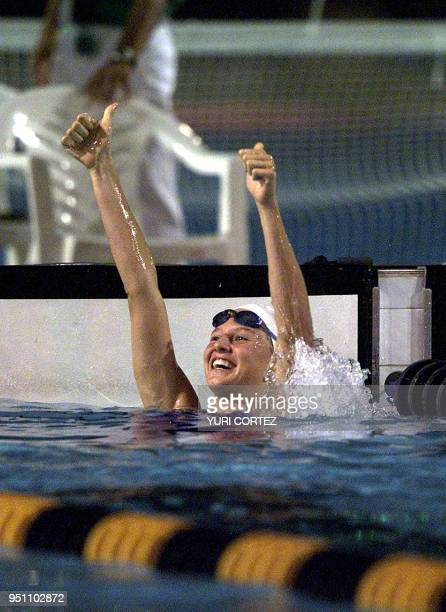 The Guatemalan Gisella Morales celebrates after winning the gold medal 29 November 2002 in the 200 meter reverse style swimming competition of the...