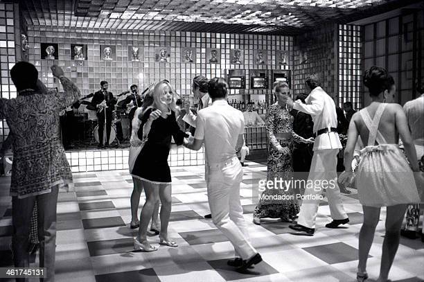 The guests, including French actress and model Capucine , dancing during the party in the halls of Ca' Vendramin Calergi offered by the Counts...