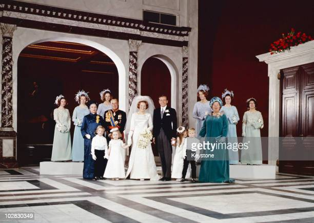 The guests pose for a portrait following the wedding of Crown Princess Beatrix of the Netherlands to Claus von Amsberg in the Town Hall in Amsterdam,...