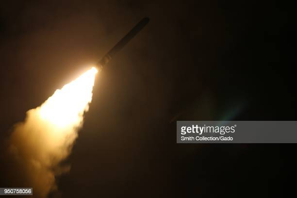 The guidedmissile destroyer USS Laboon fires a Tomahawk land attack missile at a target in Syria from the US 5th Fleet Area of Responsibility April...