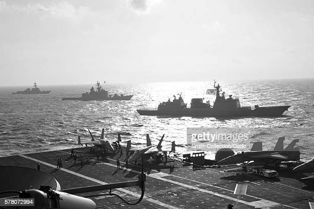 The guidedmissile destroyer USS McCampbell DDG 85 left the Japan Maritime Self Defense Force Shiraneclass destroyer JS Kurama DDH 144 and the...