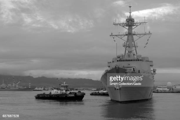 The guidedmissile destroyer USS Michael Murphy pulls away from the pier as she departs Joint Base Pearl HarborHickam Hawaii January 28 2013 Image...
