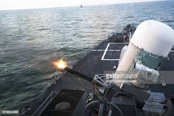 The guidedmissile destroyer USS Porter DDG 78 fires its closein weapons system during a livefire exercise as part of a passing exercise with allied...