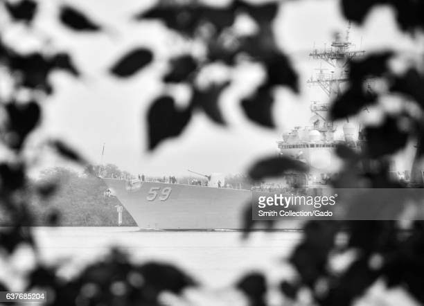 The guided-missile destroyer USS Russel departs Joint Base Pearl Harbor-Hickam for the last time, San Diego, California, January 3, 2013. Image...