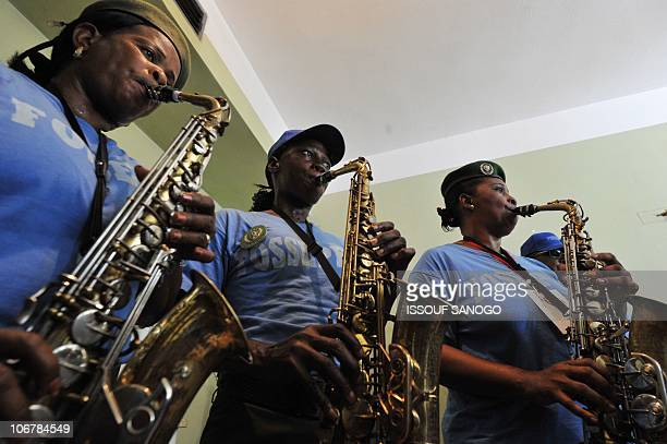 """The Guinean policewomen orchestra """"les Amazones de Guinee"""" practices during rehearsals at the peoples palace in Conakry on November 12, 2010. The..."""