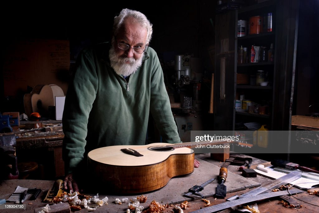 The Guitar Maker with finished guitar : Stock Photo