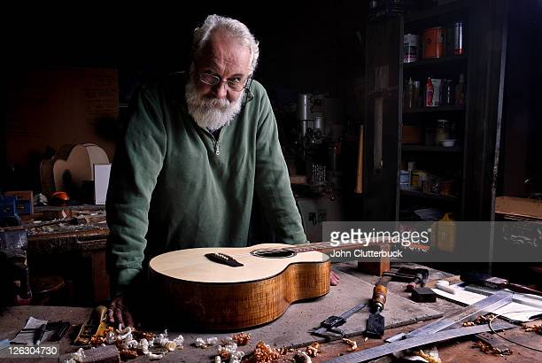 the guitar maker with finished guitar - instrument maker stock photos and pictures