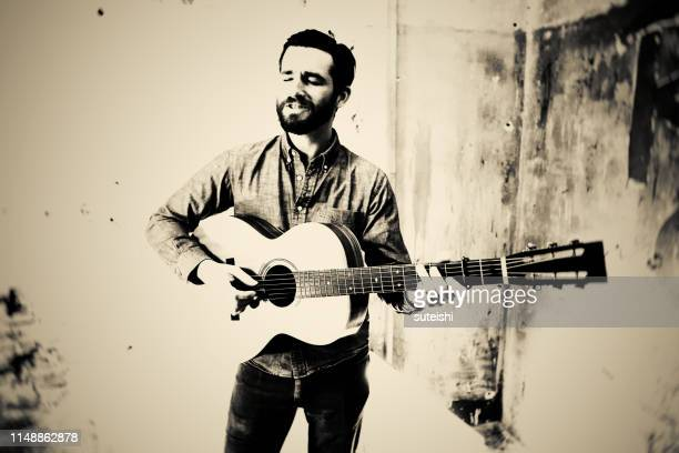 the guitar player - folk music stock pictures, royalty-free photos & images