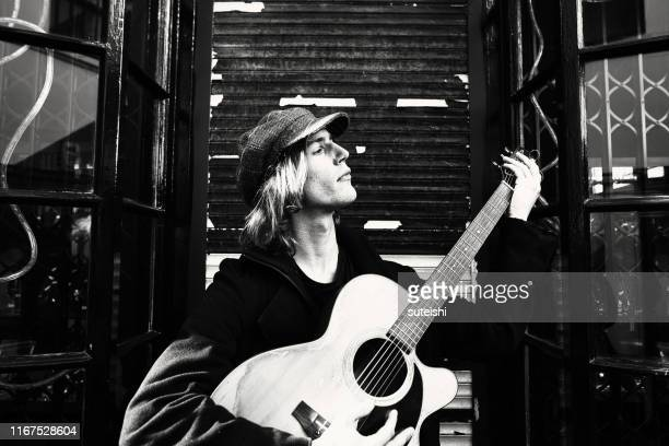 the guitar player - pop musician stock pictures, royalty-free photos & images