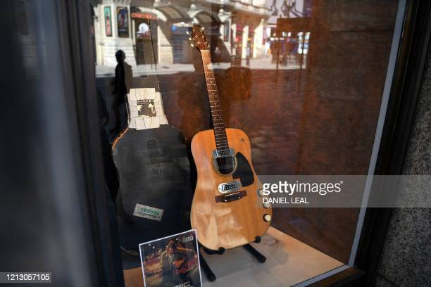 The guitar used by musician Kurt Cobain during Nirvana's famous MTV Unplugged in New York concert in 1993, is displayed in the window of the Hard...