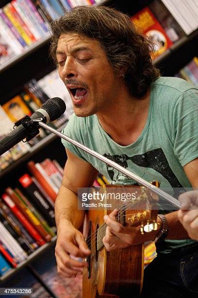The guitarist and Italian singer Federico Poggipollini guitarist of Luciano Ligabue he performed in a mini live for his fans at the Mondadori...