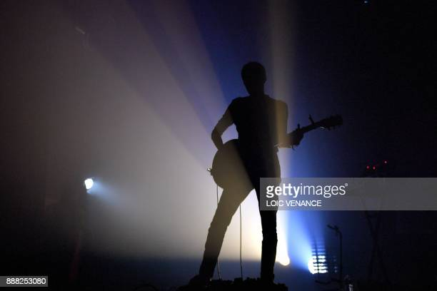 The guitarist for French singer Krismenn performs on December 7 2017 in SaintJacquesdelaLande outside Rennes as part of the 39th edition of the Trans...