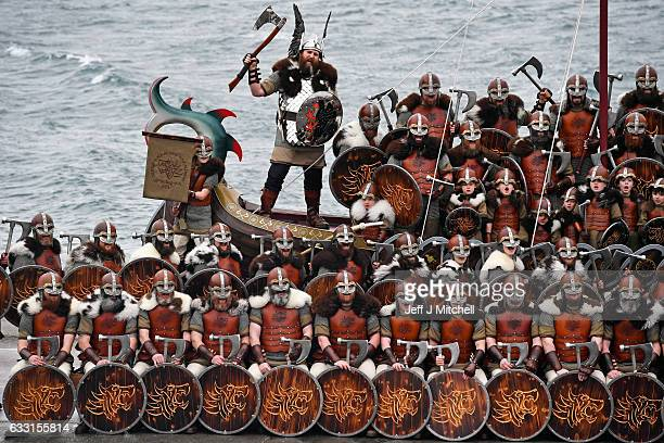 The Guizer Jarl Lyle Gair and his Jarls squad pose for a group picture at Bressay Ferry Terminal during the annual Up Helly Aa festival on January 31...