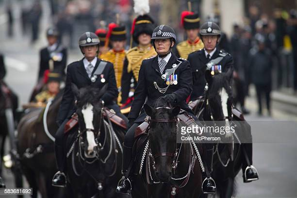 The gun carriage guarded by mounted police on horse back riding through Trafalgar Square London prior to the arrival of Margaret Thatcher's funeral...
