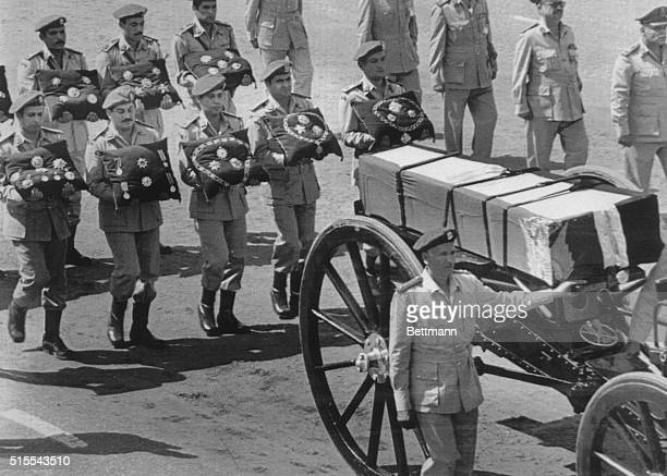 The gun carriage of slain President Anwar Sadat is escorted by armed forces bearing medals in the funeral procession here in the suburb of Nasser...