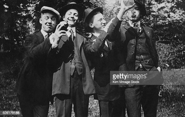 The guys get together to drink and party outside ca 1925