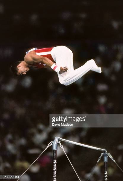 Trent Dimas of the United States performs on the high bar during the men's gymnastics competition of the 1990 Goodwill Games held from July 20 August...