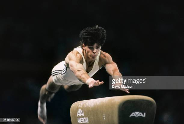 Adrian Catanoiu of Romania performs on the vault during the Men's Gymnastics competition of the 1990 Goodwill Games held from July 20 August 5 1990...