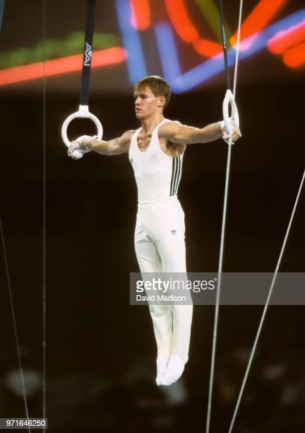 Alexandru Ciuca of Romania performs an Iron Cross on the still rings during the gymnastics competition of the 1990 Goodwill Games held from July 20...