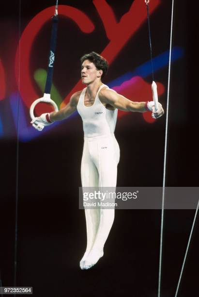 Szilveszter Csollany of Hungary performs an Iron Cross on the still rings during the gymnastics competition of the 1990 Goodwill Games held from July...